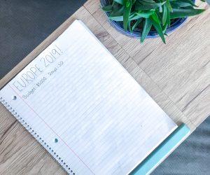 A notebook that has an example budget written down.