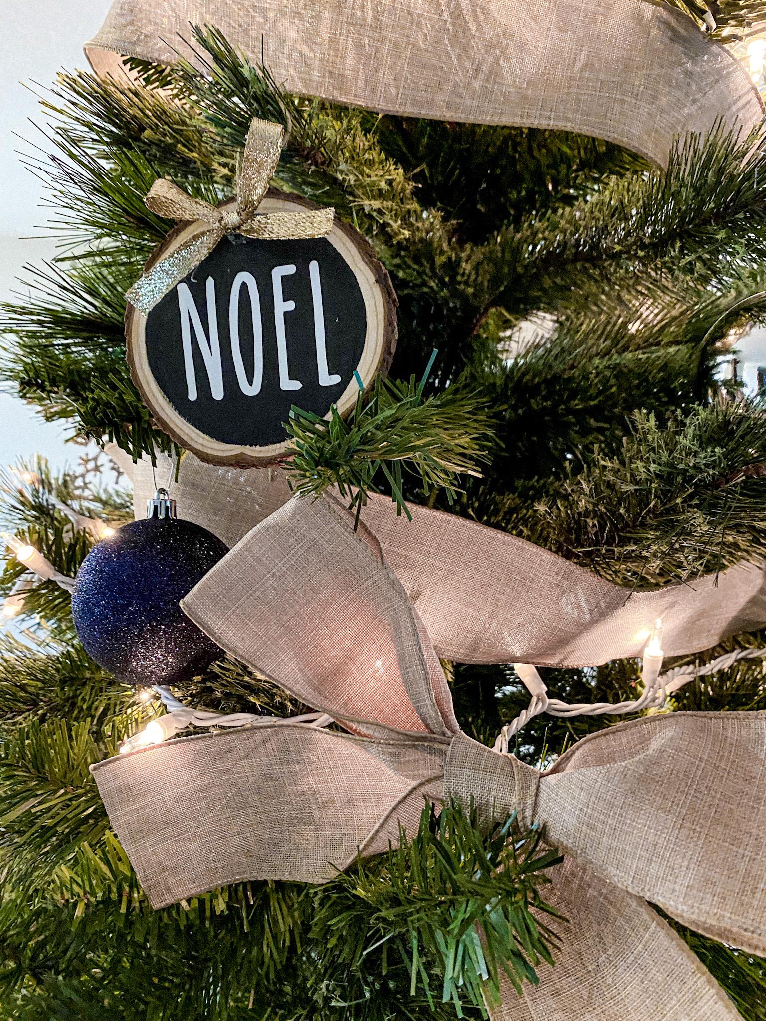 DIY wood slice ornament on a tree